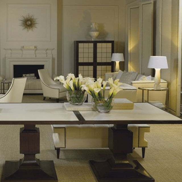 Thomas Pheasant's leather top dining table exhibits strong neoclassic influences with geometric forms. The table features...