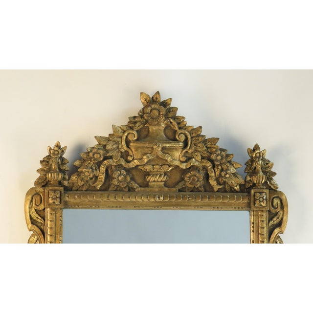 This is a French Louis XVI style gilt wood mirror. Period: 20th Century Region: France Materials:...