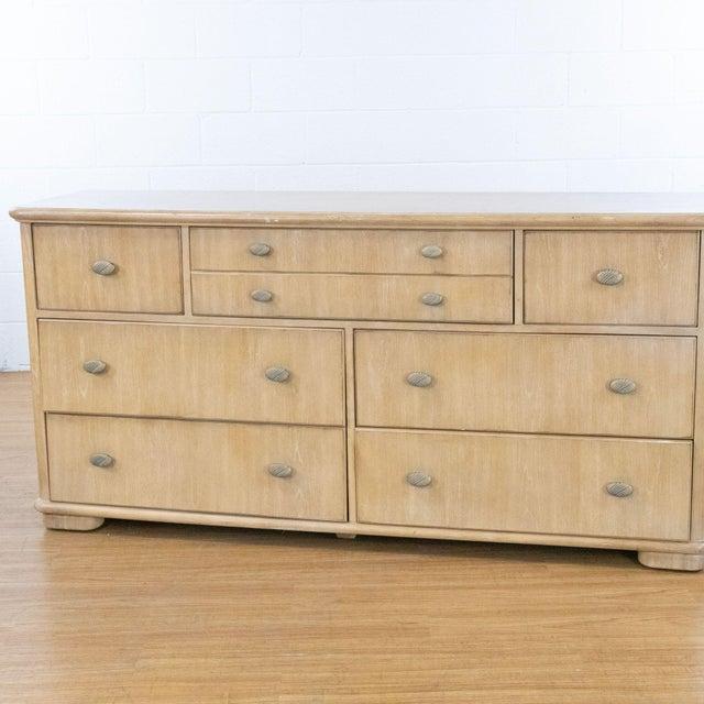 Blonde finish Drexel dresser with metal pulls. Brand isDrexel Studio. Dimensions (in): 70.0 W x 19.0 D x 34.0 H.