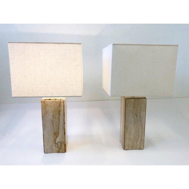 A spectacular pair of Italian travertine and polish brass table lamps from the 1970s. The lamps have been newly rewired...