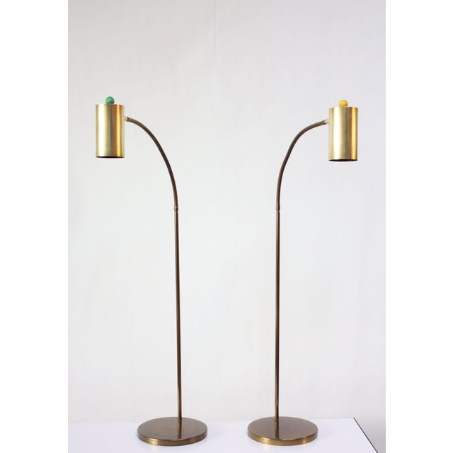 Pair of 1950s Koch and Lowy brass floor lamps with cylindrical fixtures and painted wooden 'orb' on / off knobs (one...