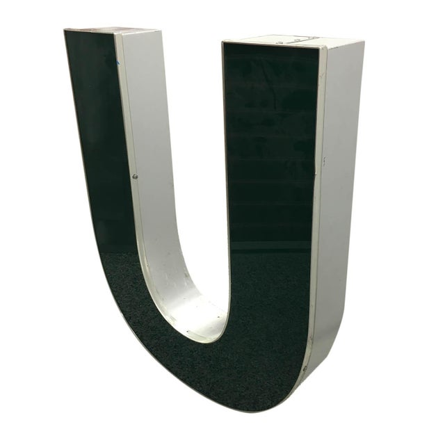 "A capital ""U"" channel letter made of aluminum and plexiglass. A lovely decorative piece to display."