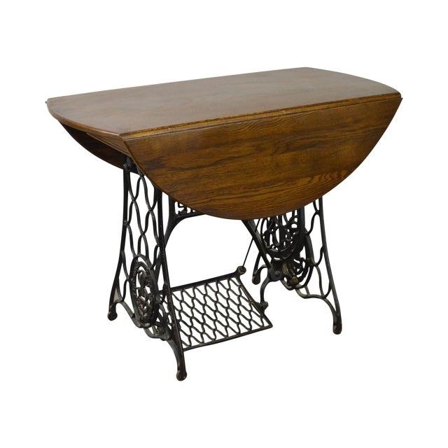 Oak drop leaf table w antique iron sewing machine base chairish oak drop leaf table w antique iron sewing machine base watchthetrailerfo