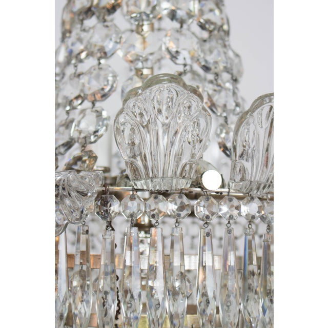 Chrome and Crystal Chandelier. Five interior lights pointing down and one up, candelabra, wired for max 60 watts. Minimum...