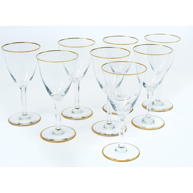 Baccarat crystal barware / tableware red wine and water glassware service for eight people with gold trim base / top ....