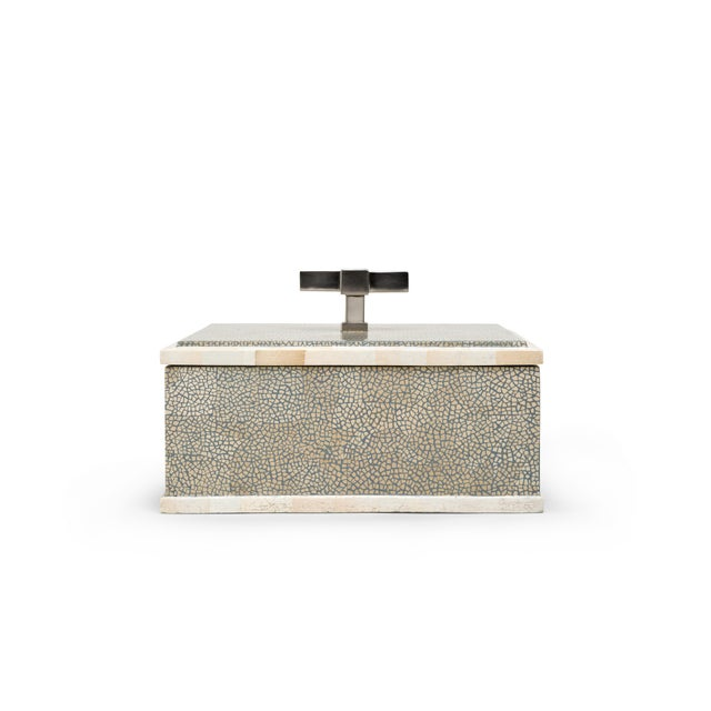 Shareen eggshell lacquer and brick eggshell lacquer withnickel handle and matte lacquer interior