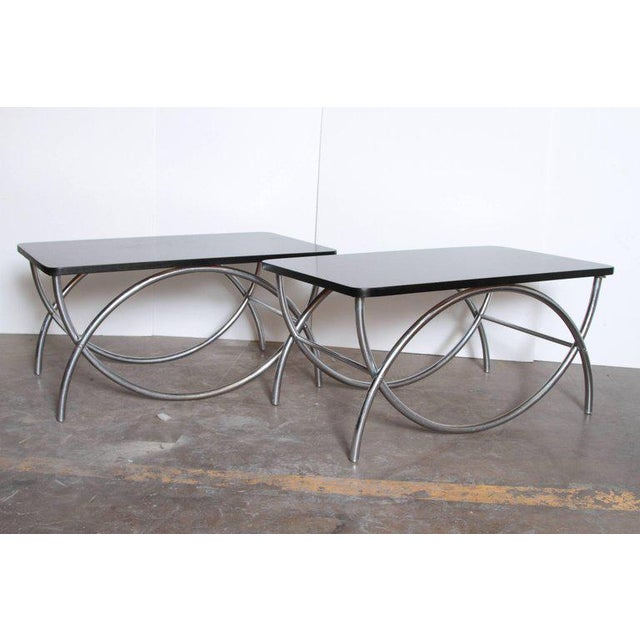 Pair of Art Deco Machine Age Wolfgang Hoffmann for Howell cocktail or coffee table Matched pair of iconic intersecting U...