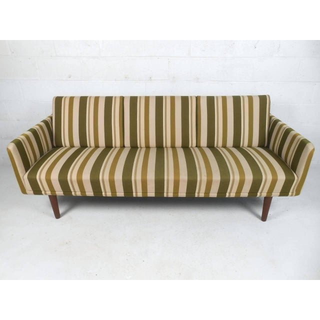 This beautiful Mid-Century sofa combines simple yet elegant lines with striking vintage upholstery. Unique yet subtle...