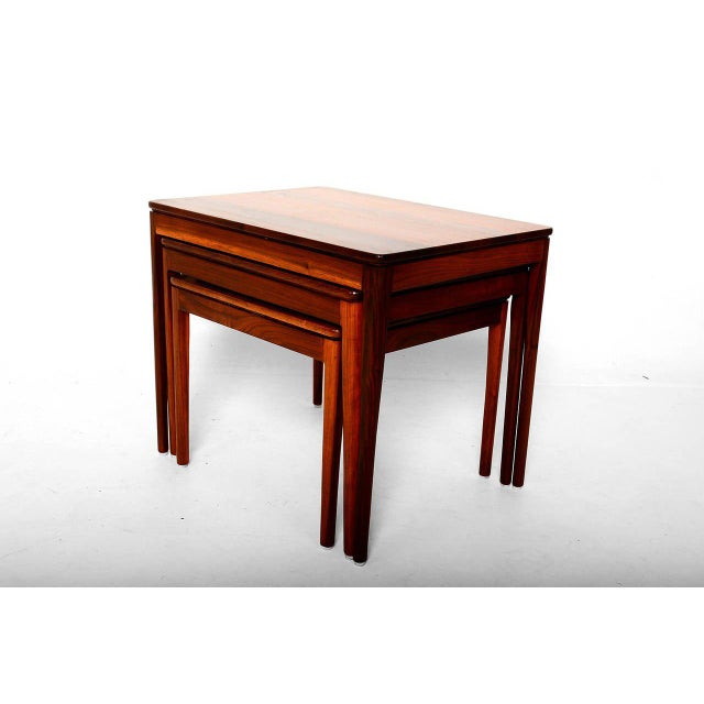 For your consideration a set of three nesting tables in walnut wood, designed by Kipp Steward for Drexel. Beautiful...