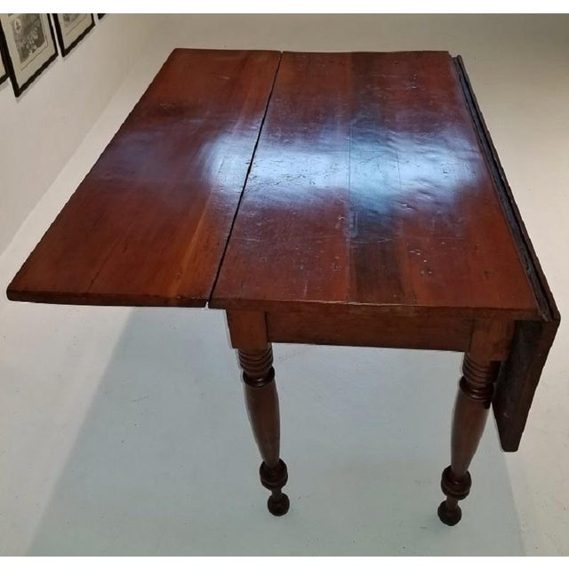 Presenting a very rare mid-19th century cherrywood drop leaf table. Made by the shakers in the Ohio river valley area,...