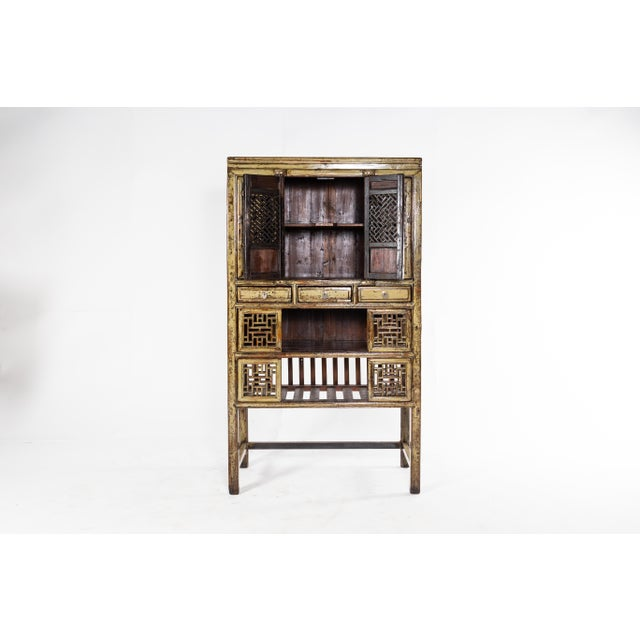 This cabinet is from Jiangsu, China and was made from pine, elm, and lacquer, circa 1920. The piece features 3 drawers, 4...