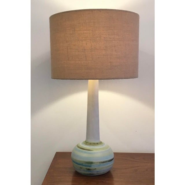 Mid-Century Modern ceramic table lamp signed Martz. Subtle bands of color offset the long neck of the lamp. Original wood...