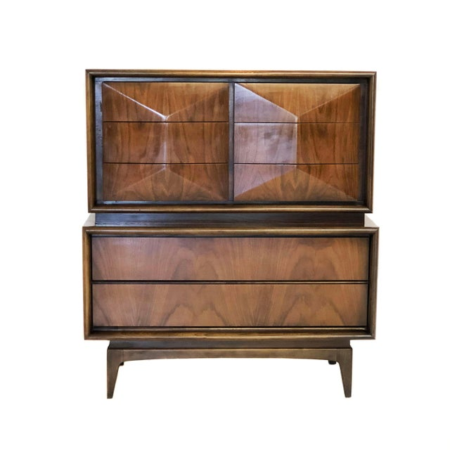 A beautiful gentleman's dresser of walnut constructed in a diamond pattern by The Venetian Furniture Company of Brooklyn....