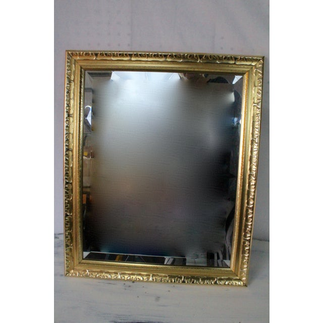 This contemporary wooden, gold painted mirror can be hung width or lengthwise and is quite a statement piece for a modern...