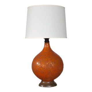 A large and iconic American 1960's burnt-orange crater-glazed ceramic lamp For Sale