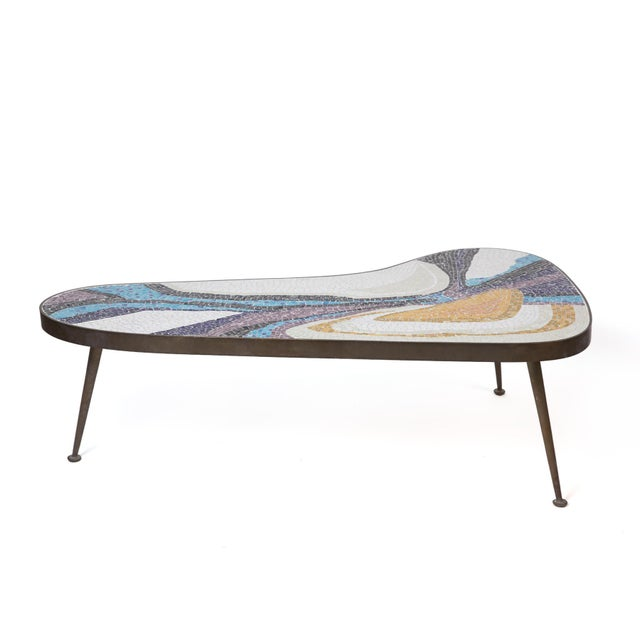 Margot Stewart mosaic and patinated brass free form coffee table from 1958. The multi-colored organic mosaic patterning...
