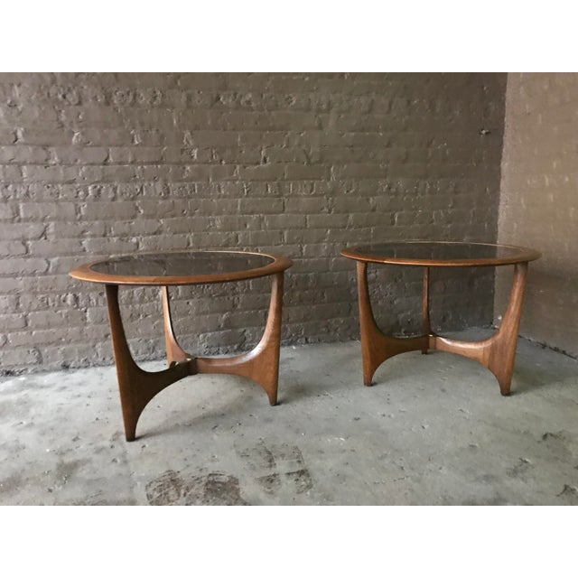 Sculptural pair of Lane walnut and glass side tables in the style of Adrian Pearsall. Good vintage condition.
