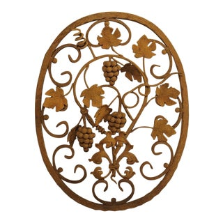 Decorative Oval Iron Wall Hanging With Scrolling Grape Vines For Sale