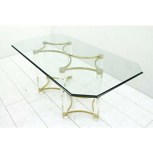 Beautiful Lucite and glass dining table from the 1980s, Romeo Paris. Good original condition. Worldwide shipping.