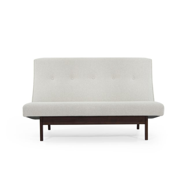 Stunning Jens Risom for Jens Risom designs settee, model U-251, circa 1950s. Sculptural walnut bases have been completely...