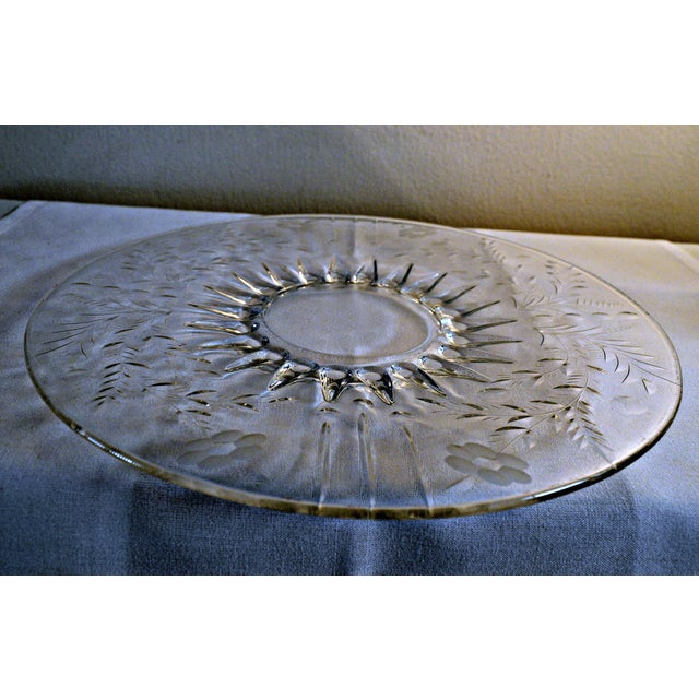 Vintage Circa 1950 brilliant clear glass server plate. Etched or wheel cut glass. Central starburst and floral motifs. Low...