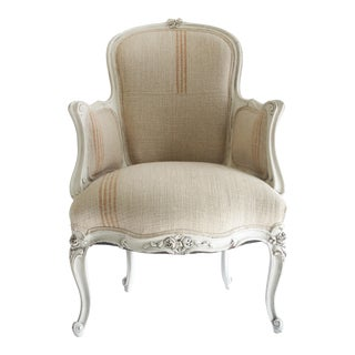 Antique Louis XV Style Painted French Bergere Chair With Linen Upholstery For Sale