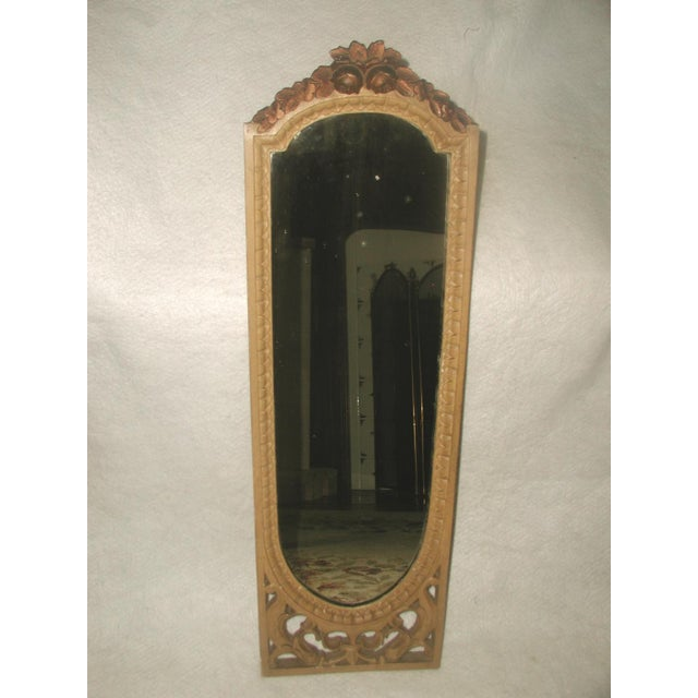 Antique petite-sized elongated arched mirror from the late 19th century. Carved deep cream frame with ornate open work...