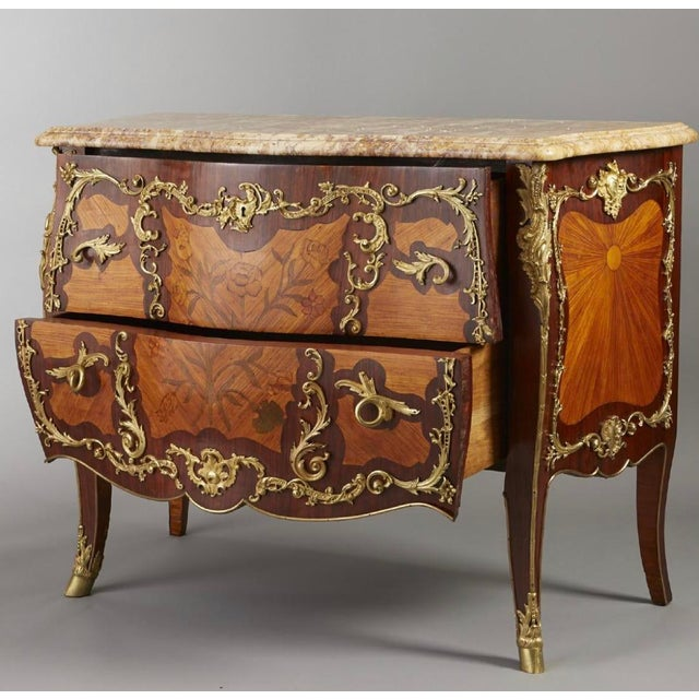 Late 19th century. A very fine Louis XV style ormolu-mounted tulipwood and amaranth marquetry commode with serpentine...