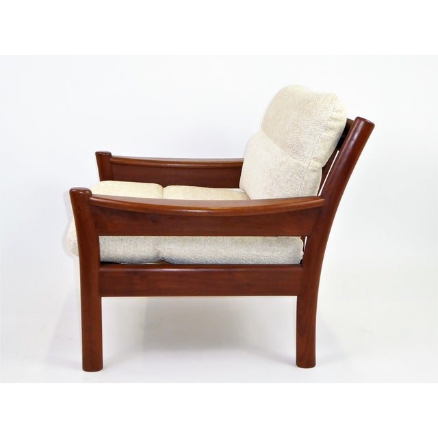 Fine 1960s Dyrlund of Denmark solid teak armchair with fitted cushions in new woven Chenille in a neutral cream color....