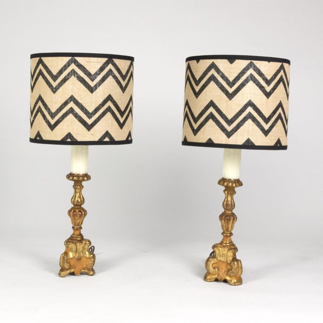 Pair of small scale carved parcel-gilt pricket sticks, French circa 1780 now mounted and wired as table lamps with custom...