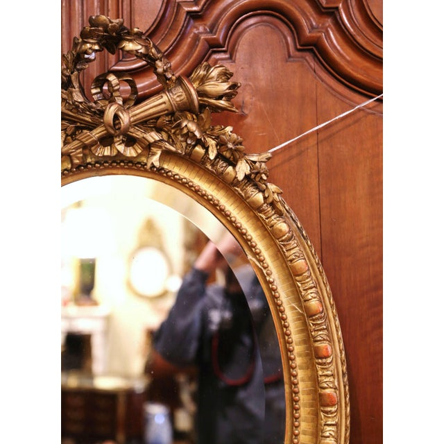 19th Century French Louis XVI Carved Giltwood Oval Wall Mirror With Torch Motif For Sale - Image 10 of 12