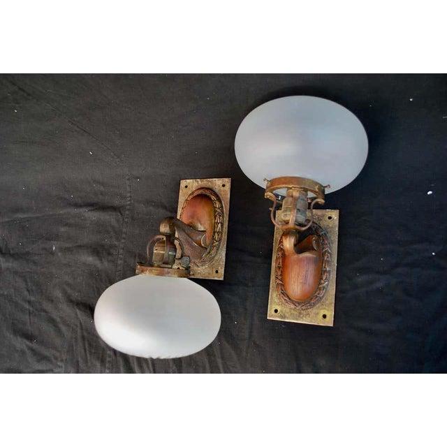 Elegant pair of 1920s outdoor/indoor sconces.