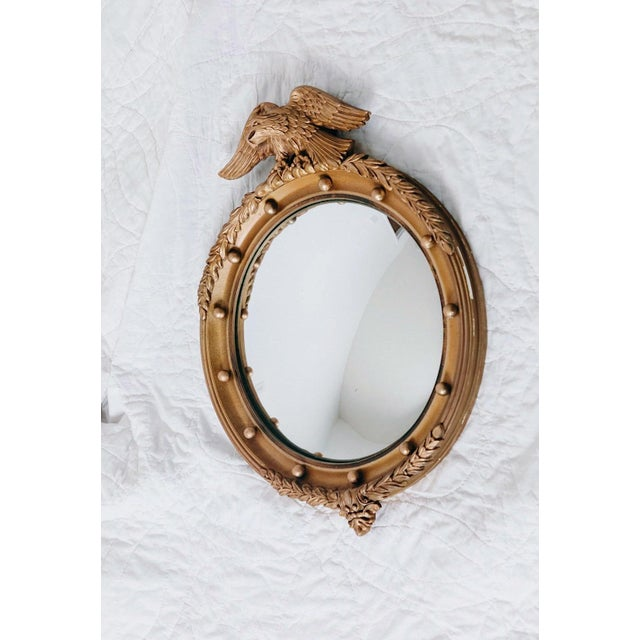 A wonderful vintage federal eagle mirror with gilt wood detailing + fabulous convex mirror center. The inside convex...