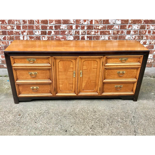 Gorgeous vintage 1970's dresser with tri-fold mirror. Made in the style of Century Furniture's Hua line this piece...