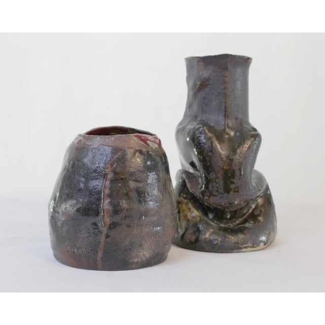 A set of hand built artisan pottery vases in surrealistically organic shapes. Created by Seattle artist Greg Warnick.
