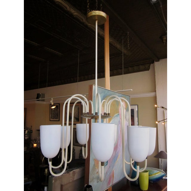 This is a gorgeous vintage Mid-Century era French modernist matte white metal chandelier. It has 9 curvilinear arms,...