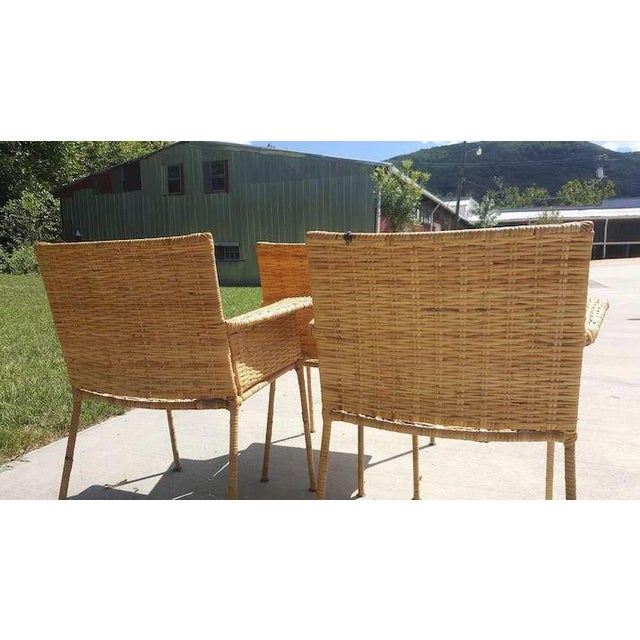 What a find! Three Wrought Iron and Wicker Chairs that are from Van Keppel and Green from the 1950's. The chair frames are...