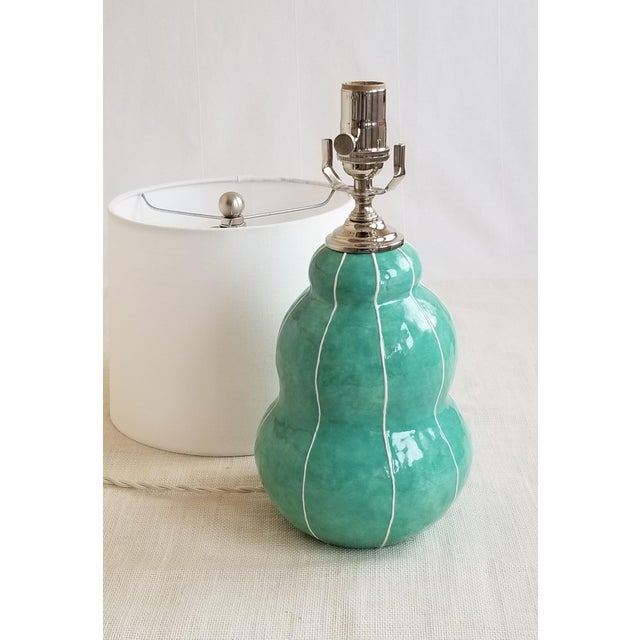 This unique, handmade ceramic table lamp is modern in style. The soft, stacked spheres suggest a turban, hence the name....