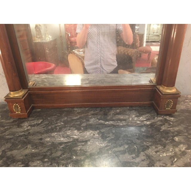 This is a quintessentially Empire style mirror with incredible bronze details. Dates from circa 1815. In good condition,...