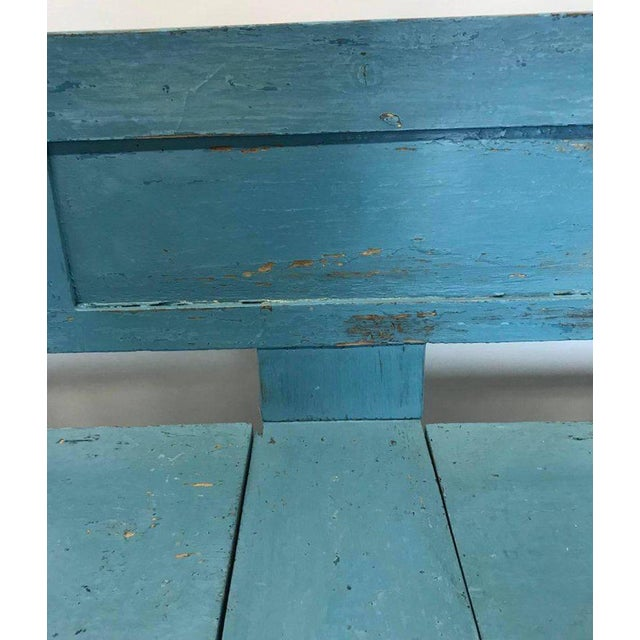 Northern European, painted bench, with two lift top storage compartments under the seats. Unusually long for this type of...