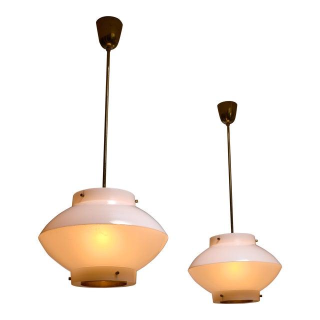 Pair of Yki Nummi White Plexiglass and Brass Pendants for Orno For Sale