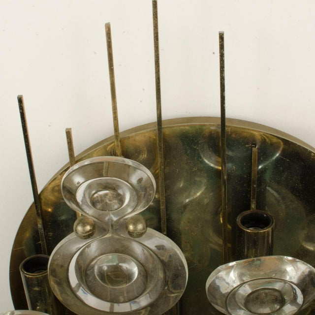 A Mid-Century Italian glass and brass sconce circa 1965. Materials: Glass, Bronze/Brass Color: Silver, clear Height: 21...