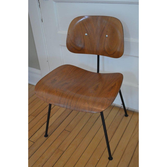 Mid-Century Modern Herman Miller walnut dining room chair, circa 1950s with new black steel frame from Herman Miller. The...