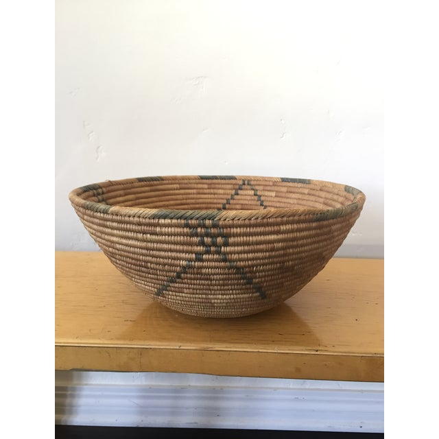 A Salish northwestern Indian basket of cedar root and rush attributed to the Salish tribe. Made in the 1950s.