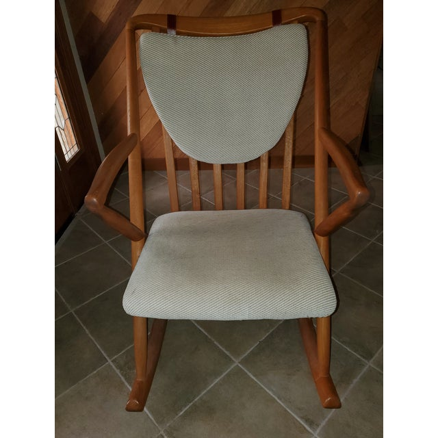 Beautiful danish modern teak rocking chair in pristine condition. Off-white fabric is very clean, no damage. Sturdy...