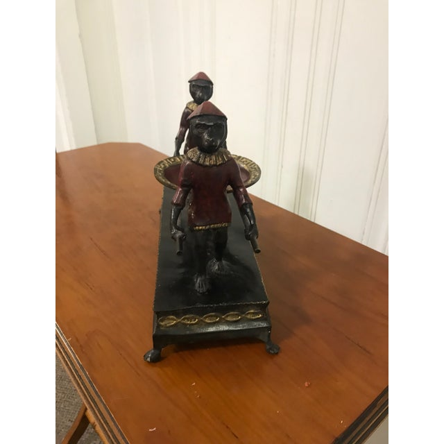 This fun monkey carrying calling card tray is a great place to store business cards or other knick-knacks. Found in...
