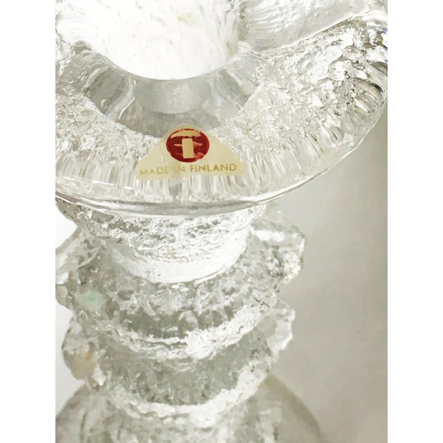 Vintage pair of Festivo candleholders in 2 sizes by Ittala of Finland. These ice-like textured clear glass pieces were...