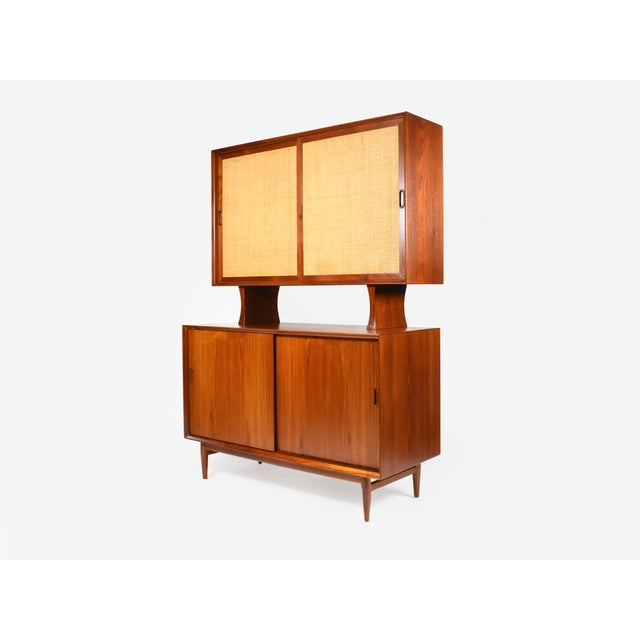 Rare Danish Modern teak sideboard hutch designed by Arne Vodder for Sibast. The credenza features two sliding doors that...
