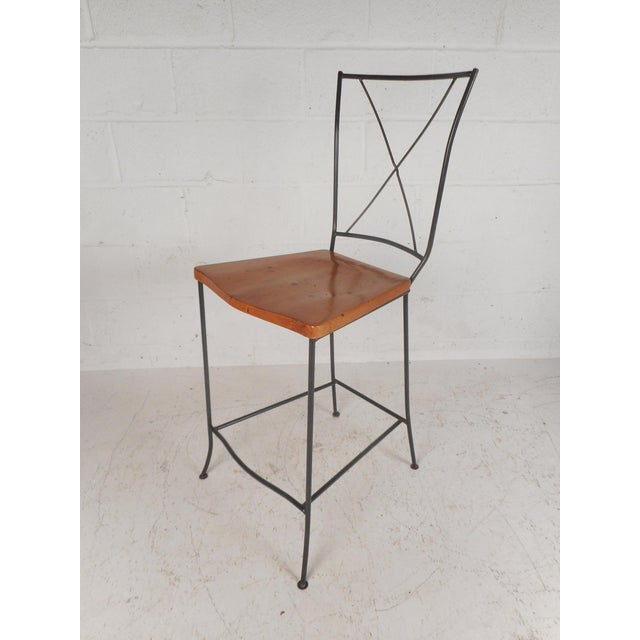 """This stunning set of four vintage modern bar stools feature iron rod frames with a an angled """"X"""" backrest. The fabulous..."""