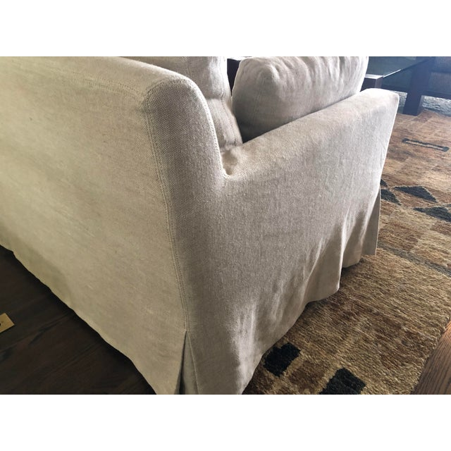 This is a Restoration Hardware Belgian track arm upholstered sofa in excellent condition. The neutral sand colored fabric...